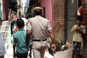 Police escorting a rescued child laborer